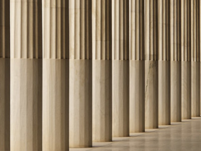 Pillars and Hallways Designed By A Limestone Company