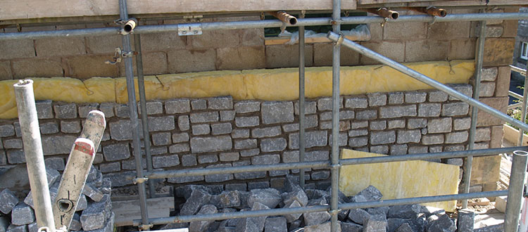 Limestone Being Used To Build Wall For House