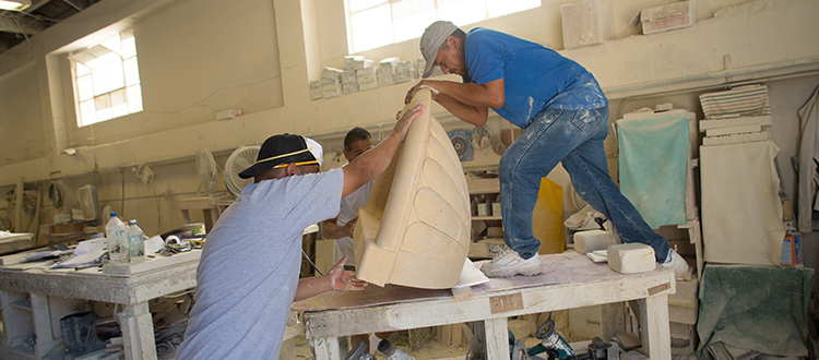 Experienced Limestone Company Working Hard to Sculpt an Ornate Decorative Piece 5-25