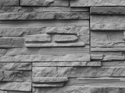 Limestone company creating cool limestone wall to add great character to house