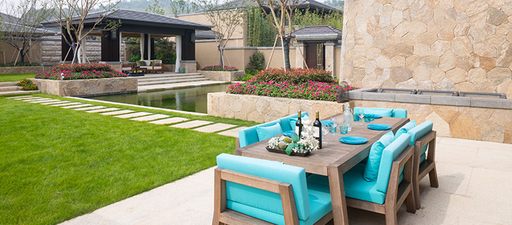 Beautiful backyard patio with limestone steps and walls