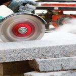 Worker-using-grinder