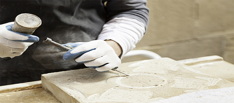 man-creating-design-in-stone