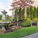 nicely-landscape-front-yard-with-fountain
