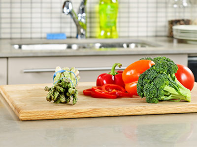 cutting-board-with-veggies-on-limestone-counter